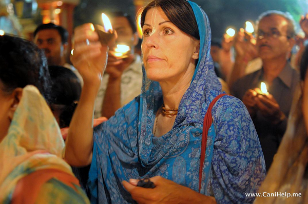 A devotee offers a lamp to the Lord with love and devotion