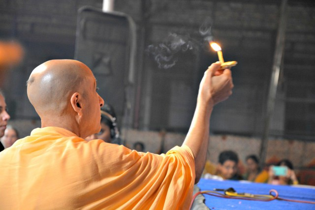 Radhanath Swami offering Lamp to Radha Damodar